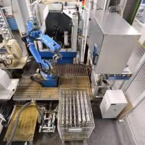 Roboterzelle zum Verketten von Maschinen zum Schleifen, Finishen und Lasern